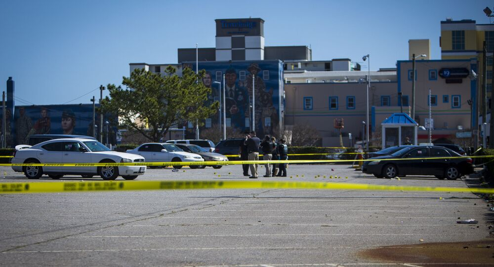 Virginia Beach police work the scene of a shooting the night before on Saturday, March 27, 2021 in Virginia Beach, Va.