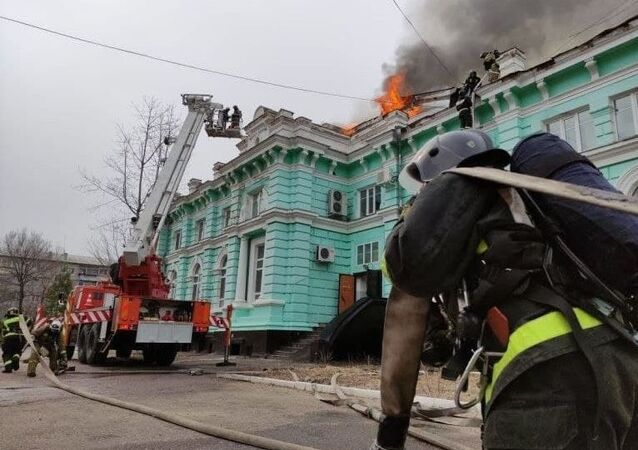 In this handout video grab released by Press-service of Russian Emergency Situations Ministry, firefighters extinguish fire at a cardiac surgery center in Blagoveshchensk, Russia.