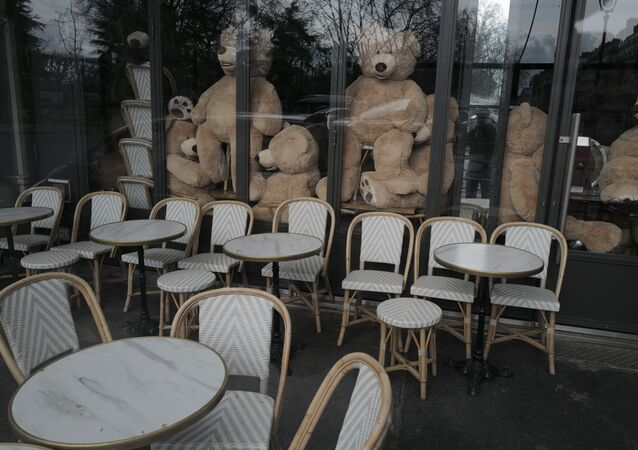 Teddy bears are placed in a restaurant by Philippe Labourel, who wants to be named 'Le papa des nounours', 'Teddy Bear father', in Paris, Sunday, March 21, 2021.