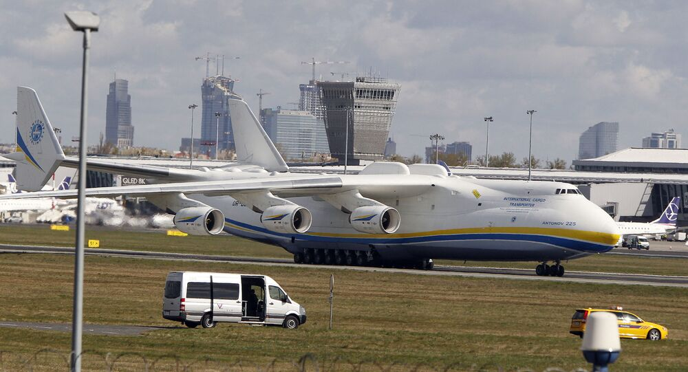 The world's largest cargo plane, the Soviet-made Antonov An-225 Mrija, lands in Warsaw's Frederic Chopin airport with a $15 million worth cargo of protective masks, outfits and visors that were bought by Poland's state-owned companies for hospitals fighting the coronavirus spread, in Warsaw, Poland, Tuesday, April 14, 2020.