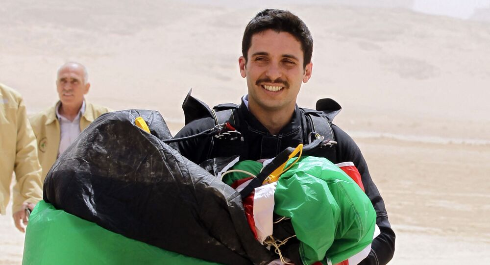 This file photo taken on 17 April 2012 shows Jordanian Prince Hamzah bin al-Hussein, president of the Royal Aero Sports Club of Jordan, with a parachute during a media event to announce the launch of Skydive Jordan, in the Wadi Rum desert.