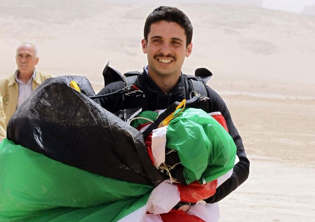 In this file photo taken on April 17, 2012 shows Jordanian Prince Hamzah bin al-Hussein, president of the Royal Aero Sports Club of Jordan, carries a parachute during a media event to announce the launch of Skydive Jordan, in the Wadi Rum desert. - A top former Jordanian royal aide was among several suspects arrested on April 3, 2021, as the army cautioned Prince Hamzah bin Hussein, the half-brother of King Abdullah II against damaging the country's security.
