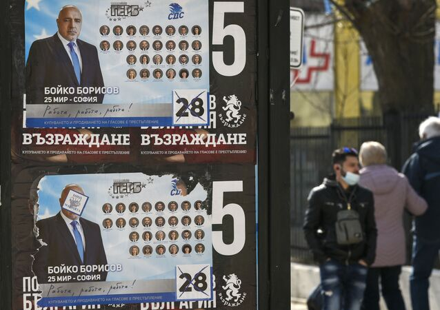 People walk past election posters of Bulgarian Prime Minister and leader of centre-right GERB party Boyko Borissov in Bankya on April 2, 2021, ahead of the General elections in two days. - Bulgarians will go to the polls on April 4, to elect a new parliament, with Prime Minister Boyko Borisov's centre-right party tipped to finish first despite a wave of anti-government protests last summer. While the latest polls give Borisov's GERB party an average lead of eight percentage points over the main opposition Socialists, analysts still expect the next parliament to be marked by more instability.