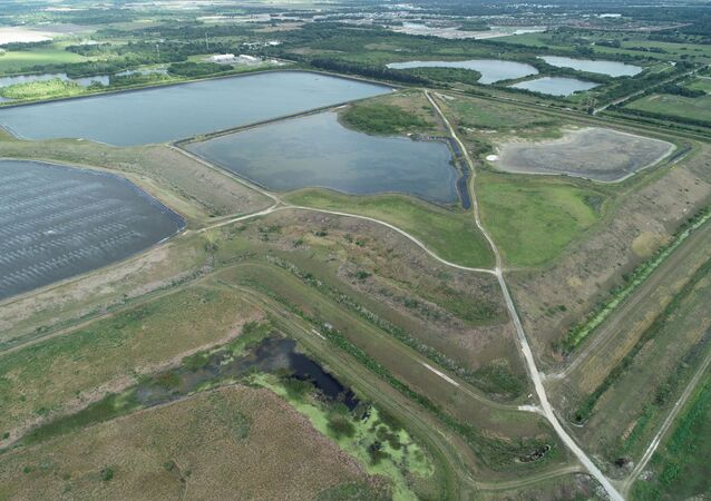 A reservoir of an old phosphate plant, the site of a breach which is leaking polluted water into the surrounding area, prompting an evacuation order in Manatee County, is seen in an aerial photograph taken in Piney Point, Florida, U.S. April 3, 2021. Picture taken April 3, 2021.