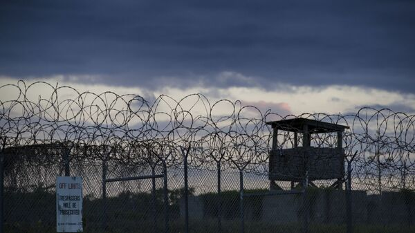 In this photo reviewed by U.S. military officials, the sun sets behind the closed Camp X-Ray detention facility, Wednesday, April 17, 2019, in Guantanamo Bay Naval Base, Cuba. - Sputnik International