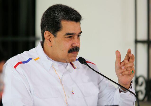 Venezuela's President Nicolas Maduro gestures during a state television address, in Caracas, Venezuela March 28, 2021.