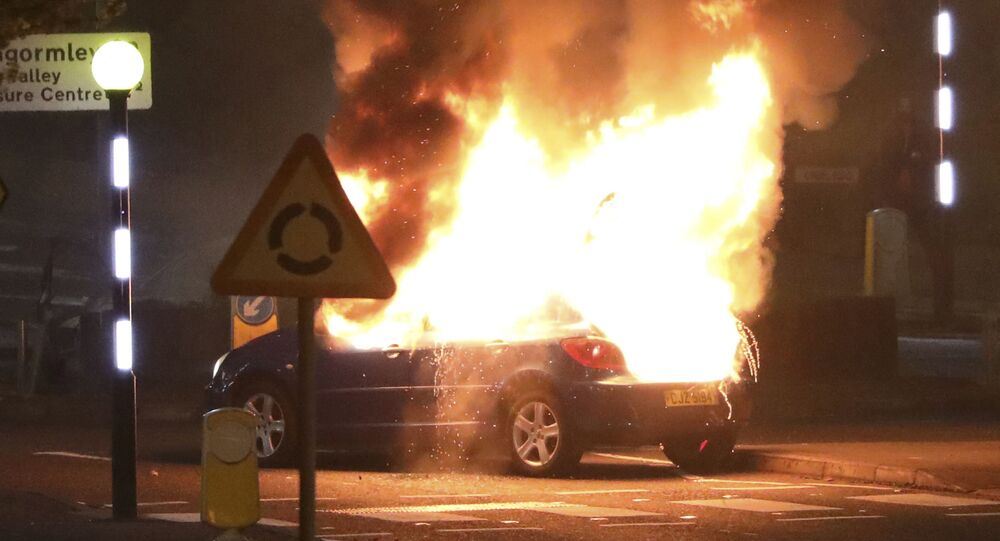 A car burns after it was hijacked by Loyalists at the Cloughfern roundabout in Newtownabbey, Belfast, Northern Ireland, Saturday, April 3, 2021.