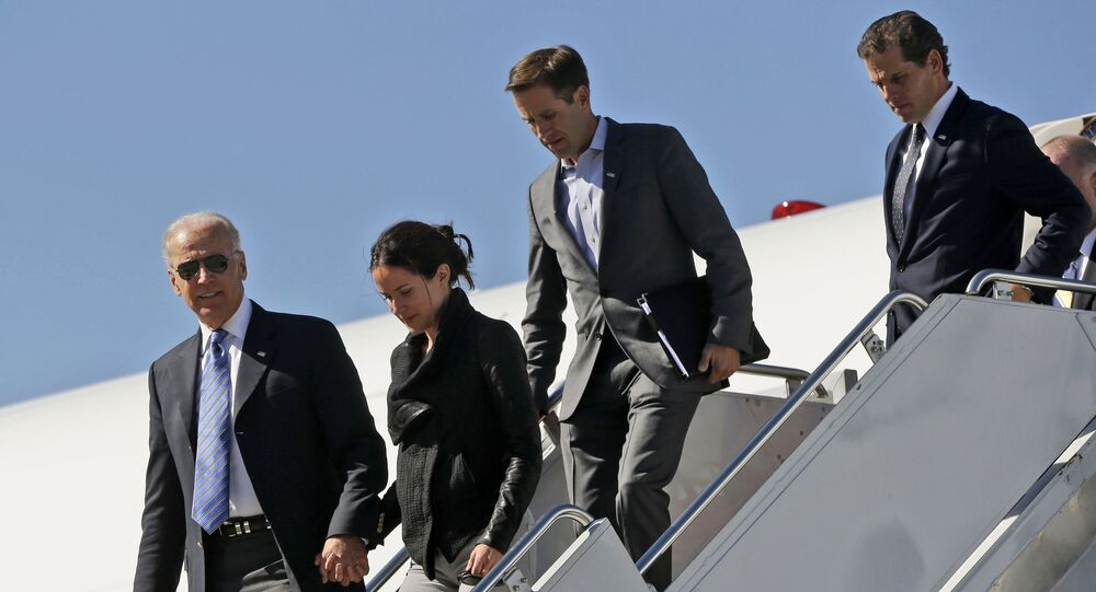 Vice President Joe Biden, left, accompanied by from second left, daughter Ashley Biden, and sons Beau Biden and Hunter Biden, walks down the steps of Air Force Two upon their arrival at Lexington Blue Grass Airport, Thursday, Oct. 11, 2012, in Lexington, Ky