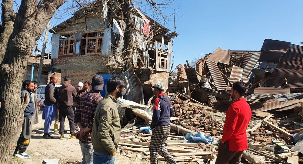 Local villagers gathered at the razed building site that was levelled in an encounter between Indian forces and militants on 2 April. Many of these villagers were involved in stone-pelting against the Indian forces after the encounter.