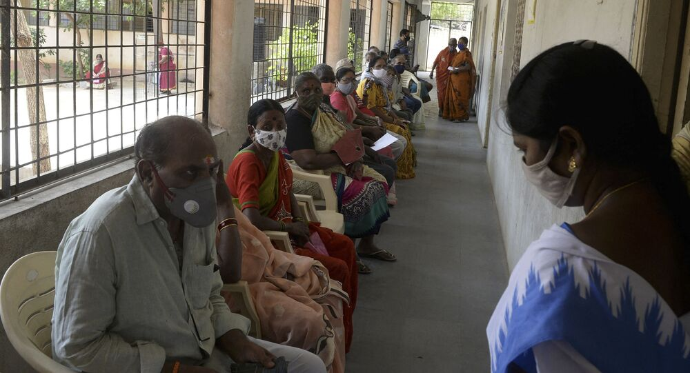 Elderly people wait for their turn to receive the dose of Covishield vaccine against the Covid-19 coronavirus at a government high school in Hyderabad on April 5, 2021