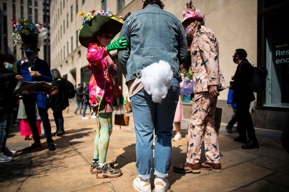 People attend the annual Easter Parade and Bonnet Festival on Fifth Avenue, amid the coronavirus disease pandemic, in New York City, US, 4 April 2021.