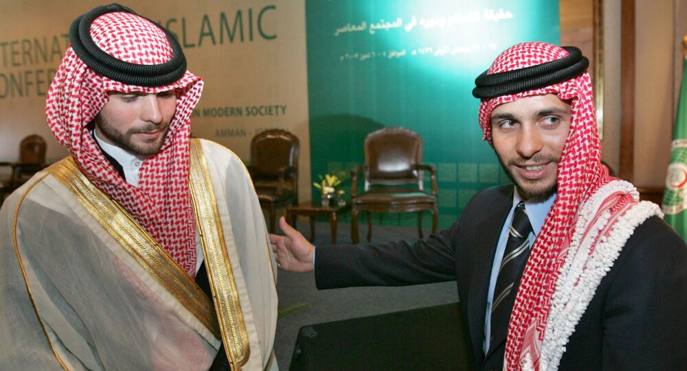 Jordan's Prince Hamzah, right, and his brother Prince Hashem, left, attend the opening session of the International Islamic Conference in Amman, Jordan, Monday, July 4, 2005.
