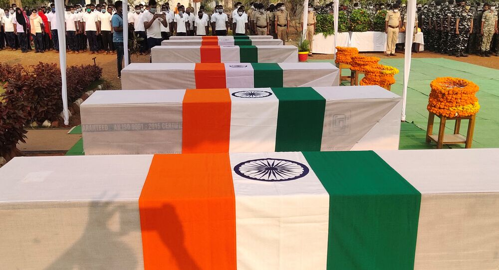 Security force personnel pay homage next to the coffins of their colleagues who were killed in an attack by Maoist fighters, during a wreath laying ceremony in Bijapur in the central state of Chhattisgarh, India, April 5, 2021