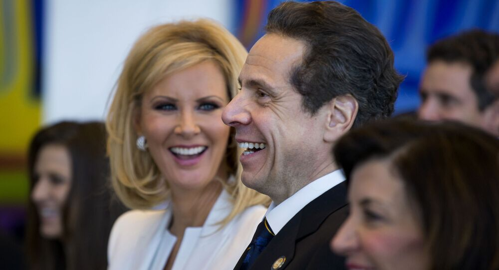 In this Jan. 1, 2015 file photo, New York Gov. Andrew Cuomo and his girlfriend Sandra Lee smile during an inaugural ceremony at One World Trade Center in New York