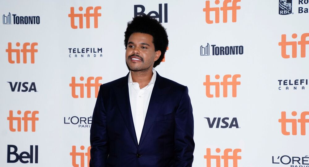 FILE PHOTO: Abel Makkonen Tesfaye, known as The Weeknd, arrives at the international premiere of Uncut Gems at the Toronto International Film Festival (TIFF) in Toronto, Ontario, Canada September 9, 2019.