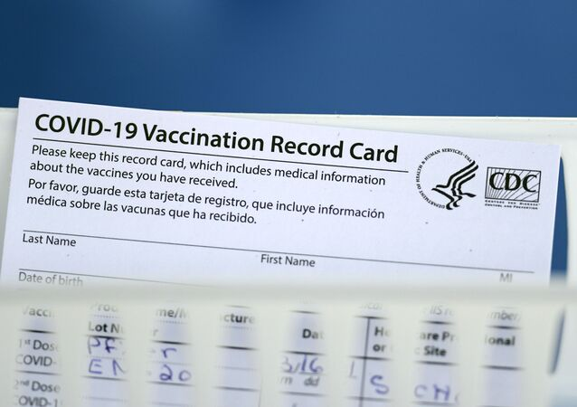 A vaccination record card is shown during a COVID-19 vaccination drive for Spring Branch Independent School District education workers Tuesday, March 16, 2021, in Houston.