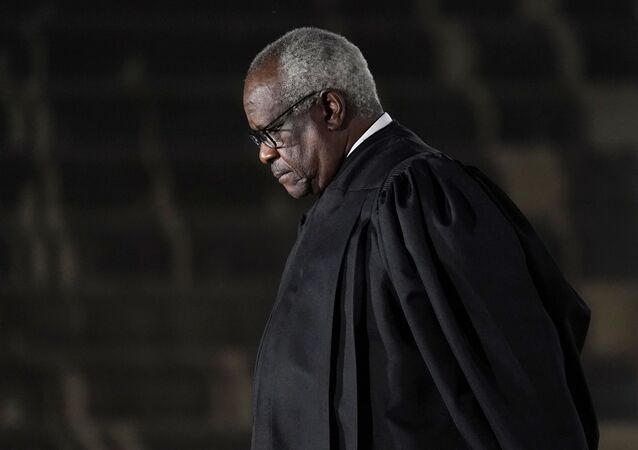 Supreme Court Justice Clarence Thomas listens as President Donald Trump speaks before administering the Constitutional Oath to Amy Coney Barrett on the South Lawn of the White House in Washington, Monday, Oct. 26, 2020, after she was confirmed by the Senate earlier in the evening.