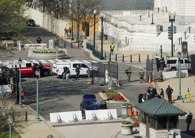 A blue car is seen after ramming a police barricade outside the U.S. Capitol building in an incident that reportedly resulted in the death of one Capitol police officer, the injury of another officer and the death of the driver as a result of police gunfire on Capitol Hill in Washington, U.S., April 2, 2021