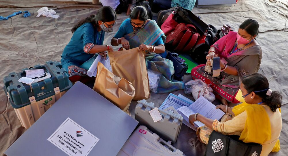 Polling officials check election materials after collecting them from a distribution centre ahead of the first phase of West Bengal state assembly election, in Purulia district, India, March 26, 2021