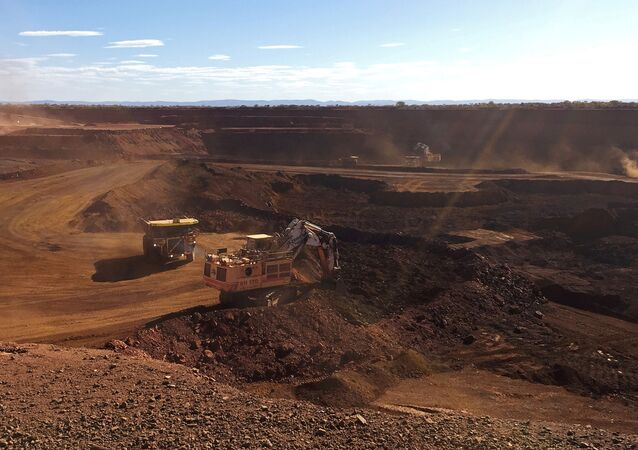 An autonomous truck readies to pick up a load of iron ore at Australia's Fortescue Metals Group (FMG) Chichester Hub, which includes the Christmas Creek iron ore mine, in the Pilbara region, located southeast of the coastal town of Port Hedland in Western Australia, November 29, 2018