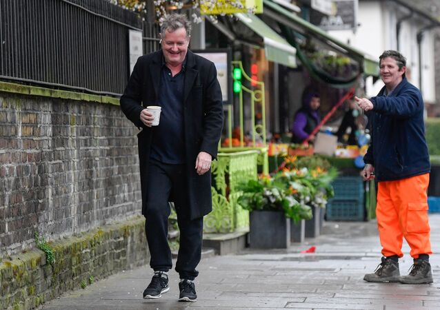 A passerby gestures to journalist and television presenter Piers Morgan, after he left his high-profile breakfast slot with the broadcaster ITV, following his long-running criticism of Prince Harry's wife Meghan, in London, Britain, 10 March 2021