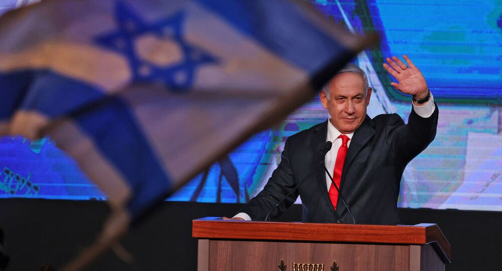 In this file photo taken on 24 March 2021, Israeli Prime Minister Benjamin Netanyahu, leader of the Likud party, addresses supporters at the party campaign headquarters in Jerusalem after the end of voting in the fourth national election in two years.