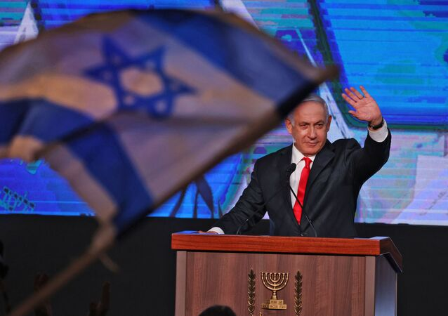 In this file photo taken on March 24, 2021, Israeli Prime Minister Benjamin Netanyahu, leader of the Likud party, addresses supporters at the party campaign headquarters in Jerusalem after the end of voting in the fourth national election in two years.