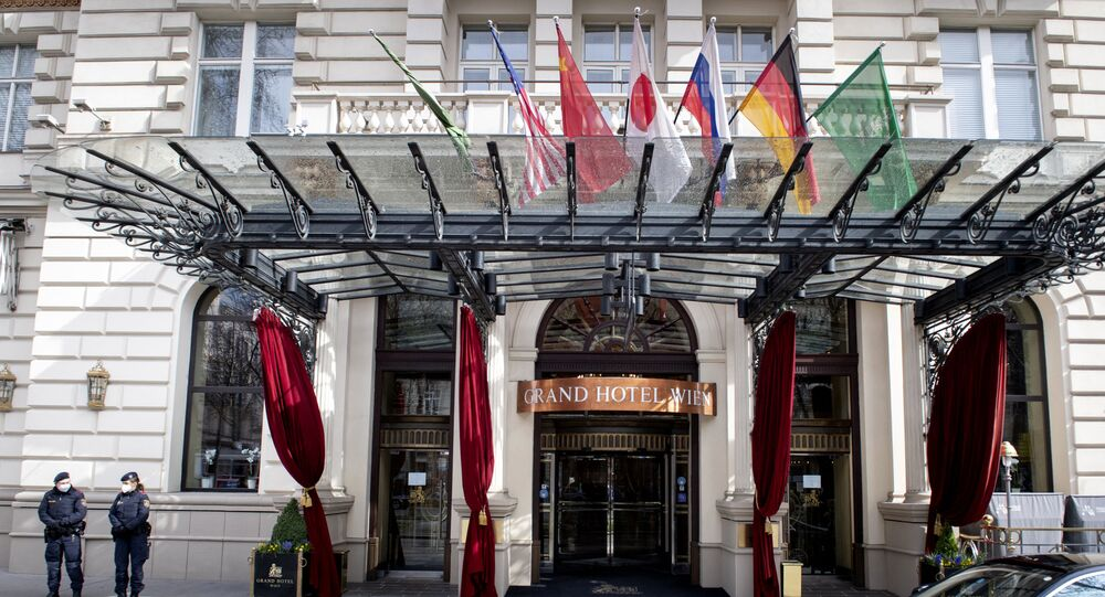 Austrian police officers stand guard near the entrance of the Grand Hotel in Vienna on April 6, 2021, where diplomats of the EU, China, Russia and Iran will hold talks.