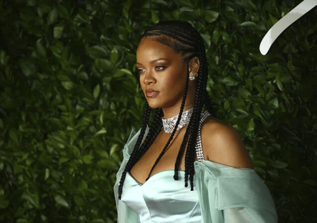 Singer Rihanna poses for photographers upon arrival at the British Fashion Awards in central London, Monday, Dec. 2, 2019