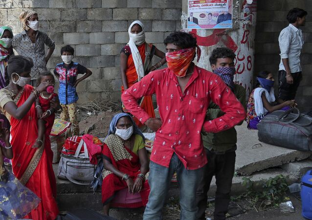 Migrant workers from the state of Maharashtra trying to return to their villages hundreds of miles away, take a break as they walk during a nationwide lockdown to curb the spread of new coronavirus on the outskirts of Hyderabad, India, Monday, 4 May 2020.