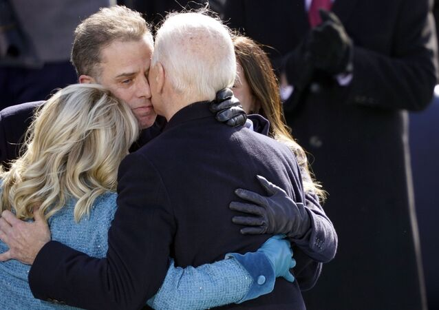 President Joe Biden hugs first lady Jill Biden, his son Hunter Biden and daughter Ashley Biden after being sworn-in during the 59th Presidential Inauguration at the US Capitol in Washington, 20 January 2021