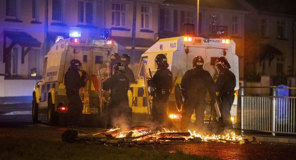 Police in riot gear try to keep control in the loyalist Waterside area of Londonderry