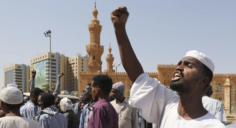 People chant slogans to protest Sudanese President of the Sovereignty Council Abdel Fattah Abdelrahman Burhan's contentious decision to meet Israel's prime minister last week in a move toward normalizing relations, in Khartoum, Sudan, Friday, Feb. 7, 2020.