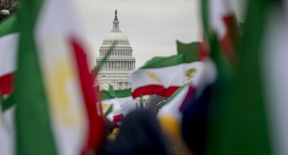 The Dome of the U.S. Capitol building is visible through Iranian flags during an Organization of Iranian-American Communities rally at Freedom Plaza in Washington, Friday, March 8, 2019.