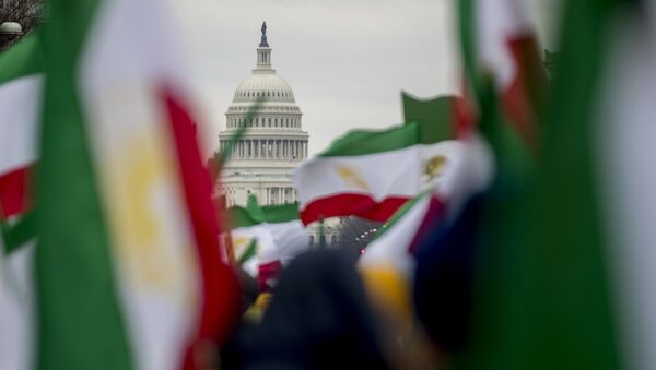 The Dome of the U.S. Capitol building is visible through Iranian flags during an Organization of Iranian-American Communities rally at Freedom Plaza in Washington, Friday, March 8, 2019.  - Sputnik International