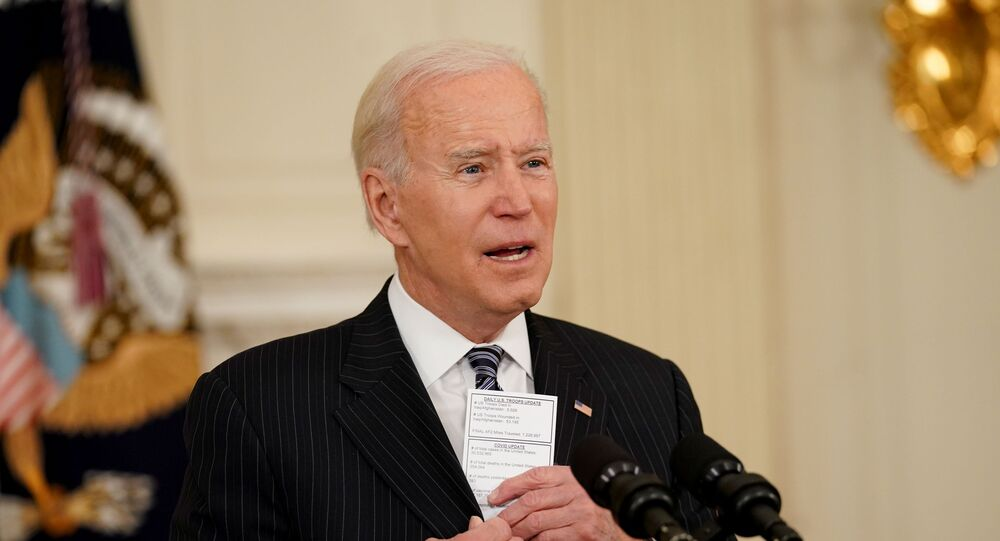 U.S. President Joe Biden holds a card with the number of people who have died of the Coronavirus disease as he delivers remarks on the state of the coronavirus disease (COVID-19) vaccinations from the State Dining Room at the White House in Washington, D.C., U.S., April 6, 2021.