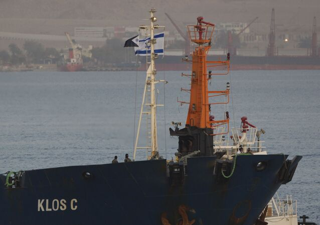 Israeli commandos stand guard on the seized KLOS-C cargo ship as it enters the port, at the Red Sea resort city of Eilat, southern Israel, Saturday, March 8, 2014. Israeli naval forces raided the ship hundreds of miles from Israel, in the Red Sea on Wednesday and seized dozens of advanced rockets from Iran destined for Palestinian militants in Gaza, according to the Israeli military. The Islamic Jihad, an Iranian-backed militant group in the Gaza Strip says it is not involved in a seized missile shipment.