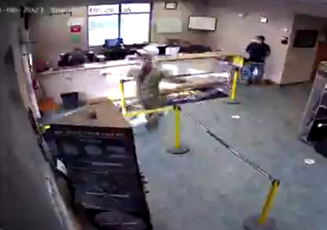 Screenshot from a surveillance video showing a wounded US Navy sailor staggering inside the Nicolock paving manufacturer facility seeking help after the shooting near Fort Detrick