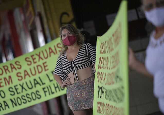 Sex workers protest at Rua Guaicurus, the main bohemian area of Belo Horizonte, in the state of Minas Gerais, Brazil on 5 April 2021, asking to be considered a priority group to receive the vaccine against COVID-19