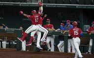 Texas Rangers' Rougned Odor (12) and Elvis Andrus celebrate Odor's two run home run that also scored Nick Solak (15) in the eighth inning of a baseball game against the Oakland Athletics in Arlington, Texas, Friday, Sept. 11, 2020