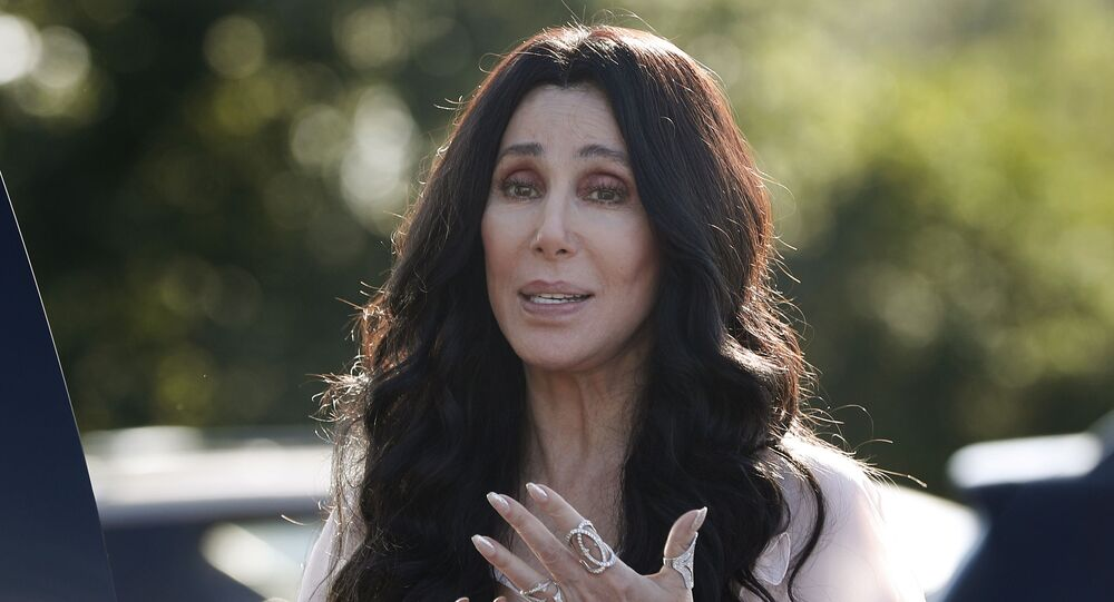 Singer and actress Cher stops to talk to media as she leaves a fundraiser for Democratic presidential candidate Hillary Clinton at the Pilgrim Monument and Provincetown Museum in Provincetown, Mass., Sunday, Aug. 21, 2016.