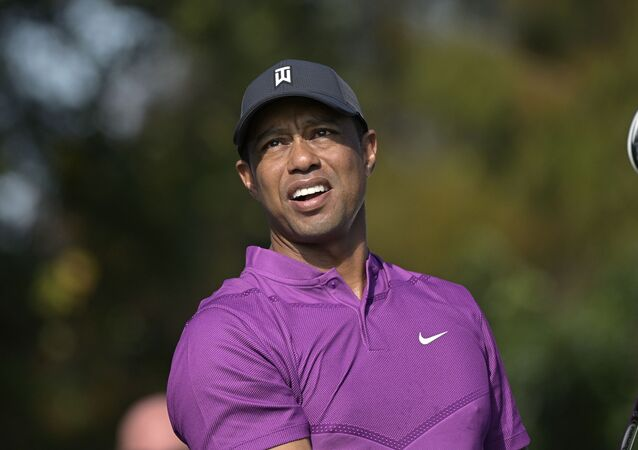 Tiger Woods watches his tee shot on the first hole during the first round of the PNC Championship golf tournament, Saturday, Dec. 19, 2020, in Orlando, Fla.
