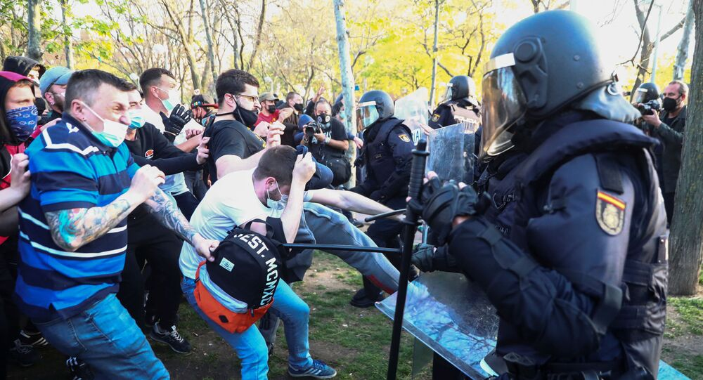 Police officers clash with counter protesters during a political meeting of the far-right party VOX in Madrid, Spain, April 7, 2021.