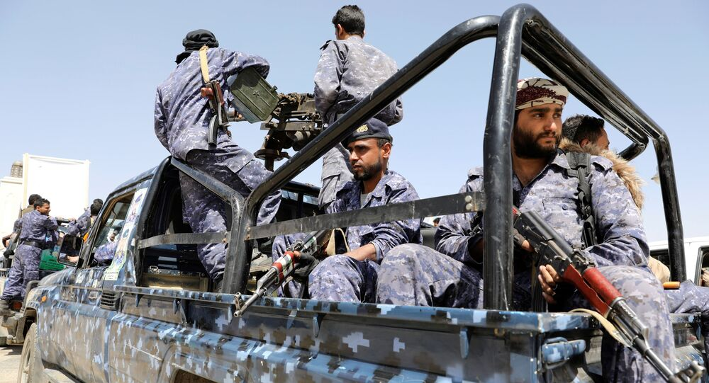 Police troopers ride on the back of a patrol truck following a funeral of Houthi fighters killed during recent fighting against government forces at different fronts, in Sanaa, Yemen March 23, 2021