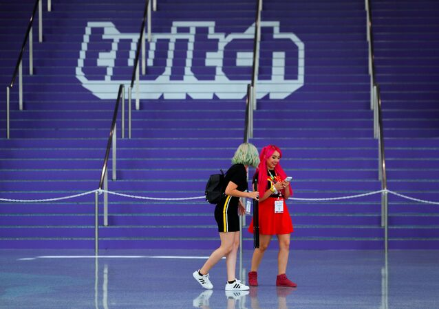 FILE PHOTO: Attendees walk past a Twitch logo painted on stairs during opening day of E3, the annual video games expo revealing the latest in gaming software and hardware in Los Angeles, California, U.S., June 11, 2019.