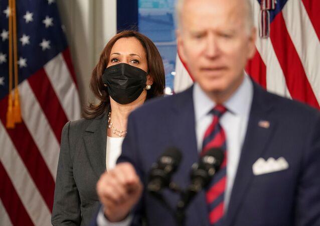 U.S. Vice President Kamala Harris listens as President Joe Biden speaks about jobs and the economy at the White House in Washington, U.S., April 7, 2021