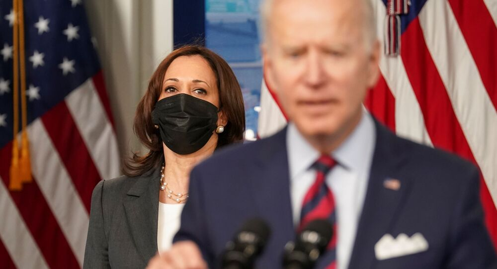 US Vice-President Kamala Harris listens as President Joe Biden speaks about jobs and the economy at the White House in Washington, DC, US, 7 April 2021.