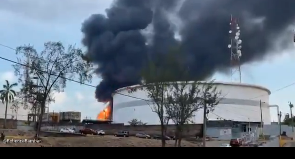 A screenshot from footage of an explosion at an oil refinery in the city of Minatitlan, in the eastern Mexican state of Veracruz.