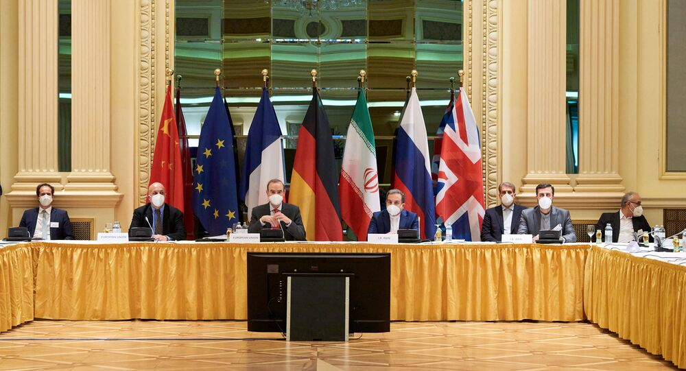 In this Handout photo made available by the EU delegation in Vienna shows  Diplomats of the EU, China, Russia and Iran at the start of talks at the Grand Hotel in Vienna on April 6, 2021. - The US will participate in discussions in Vienna to try to save the international agreement on Iranian nuclear power. However, they will not be at the same table as Tehran and it is the Europeans who will serve as intermediaries between the two parties, in the hope of achieving concrete results after two months of impasse.