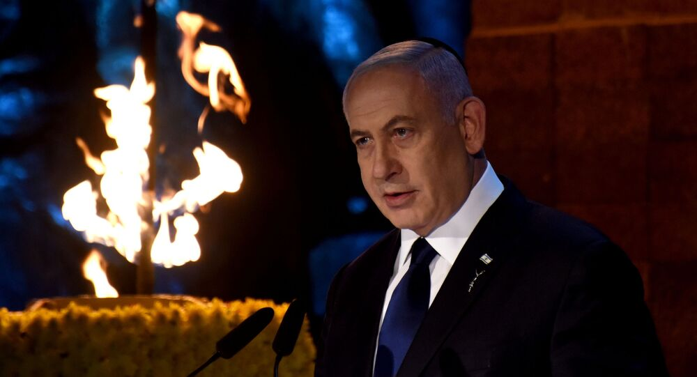 Israeli Prime Minister Benjamin Netanyahu delivers a speech at the Holocaust Martyrs' and Heroes Remembrance Day opening ceremony in memory of the six million Jewish men, women and children murdered by the Nazis and their collaborators, at Yad Vashem Holocaust Museum in Jerusalem April 7, 2021